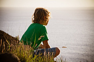 Boy looking at ocean