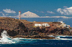 Snowcapped Teide and the lighthouse of Sardina de Gáldar