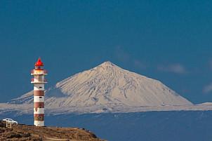 Snowcapped Teide and the lighthouse of Sardina de Gáldar