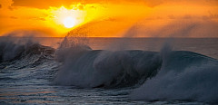 Sunset over wave